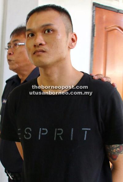 Kuo dibawa keluar dari mahkamah selepas dijatuhkan hukuman 14 hari penjara kerana menghina mahkamah.