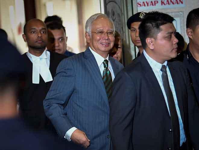 Najib keluar dari mahkamah selepas didakwa atas tiga pertuduhan menerima wang hasil daripada aktiviti haram di Mahkamah Tinggi Kuala Lumpur, semalam. — Gambar Bernama