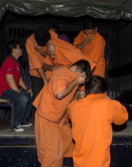 Empat lelaki termasuk seorang pegawai keselamatan sebuah syarikat pemaju didakwa di Mahkamah Majistret di Petaling Jaya semalam atas tuduhan merusuh dengan menggunakan senjata berbahaya dalam kekecohan di Kuil Sri Maha Mariamman, Subang Jaya, minggu lalu. — Gambar Bernama