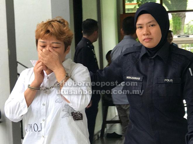 Wei dibawa ke mahkamah bagi menghadapi dua pertuduhan menipu.