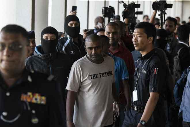 Antara 12 individu yang didakwa di Mahkamah Sesyen dekat Kuala Lumpur, semalam berhubung kumpulan pengganas Harimau Pembebasan Tamil Eelam (LTTE). — Gambar Bernama