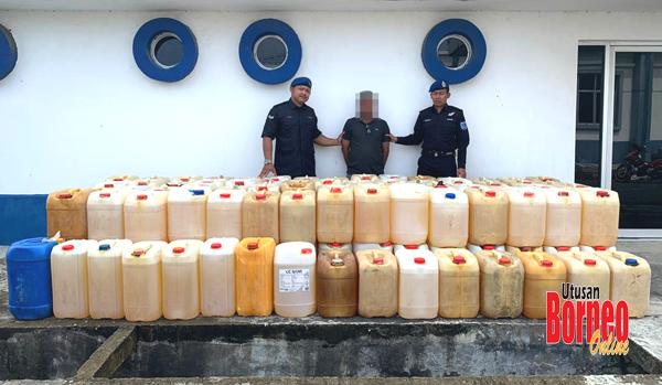 Suspek dan minyak petrol yang berjaya ditahan oleh anggota PPM.