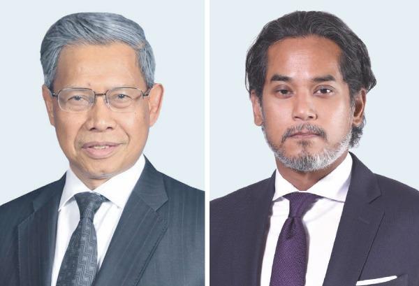 Dato' Sri Mustapa bin Mohamed (kiri) dan Khairy Jamaluddin.