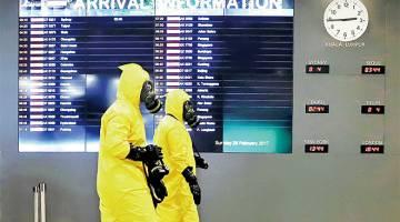 TERKAWAL: Anggota pasukan Hazmat menjalankan pemeriksaan di terminal KLIA2 di Sepang, semalam. — Gambar Reuters