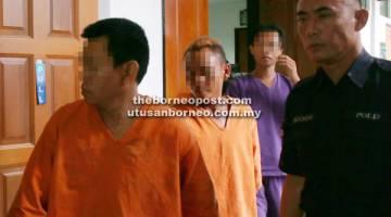 REMAN: Suspek (tengah) dibawa balik ke lokap selepas perintah reman tujuh hari diperolehi.