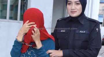 DIDAKWA: Nor Solihah ibu kepada Muhammad Adam Daniel didakwa di Mahkamah Sesyen dekat Kajang, semalam berhubung kes penderaan anaknya sehingga mati, dua minggu lepas. — Gambar Bernama