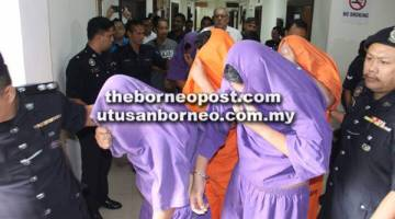 TANGKAP: Suspek dibawa ke Mahkamah Majistret Kuching untuk permohonan reman semalam.