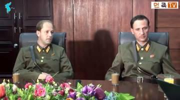 PEMBELOT: Rakaman skrin video YouTube tidak bertarikh terbitan Uriminzokkiri semalam menunjukkan Ted (kanan) dan adiknya James semasa ditemu bual di satu lokasi tidak didedahkan. — Gambar AFP