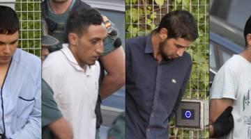 DIDAKWA: Kombinasi gambar yang dirakam kelmarin menunjukkan (dari kiri) Chemlal, Oukabir, Karib dan Aallaa ketika dieskot Pengawal Sivil Sepanyol dari pusat tahanan reman di Tres Cantos, Madrid untuk dipindahkan ke Mahkamah Negara. — Gambar AFP