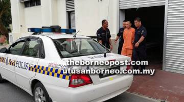 TIADA PENGAKUAN: Tertuduh dieskot keluar dari bangunan mahkamah ke kenderaan polis setelah dituduh di Mahkamah Majistret semalam atas tuduhan membunuh Nasreen Tan yang sepatutnya menyambut hari jadinya yang ke-13 bulan depan.