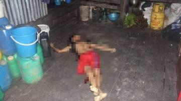 KEADAAN mangsa yang terlentang di lantai dapur selepas ditetak di bahagian muka dan perut.