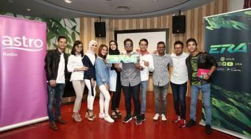 PENCARIAN BAKAT BAHARU: Dhan (tiga kanan) bersama dengan barisan artis yang turut serta dalam memeriahkan pelancaran program pencarian bakat baharu 'Cover Star ERA' yang diadakan di Kuala Lumpur baru-baru ini.