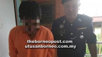 BERSALAH: Tertuduh diiringi anggota polis ketika dibawa keluar dari Mahkamah Majistret Lawas, semalam.