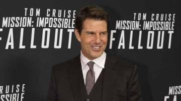 UNGGULI CARTA: Gambar fail yang diambil pada 22 Julai 2018 menunjukkan Tom Cruise tiba untuk tayangan 'Mission Impossible - Fallout' di Washington, DC. 'Mission: Impossible -- Fallout' mengungguli box office AS pada hujung minggu.  — Gambar AFP