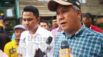 MA'MUN (kanan) dan Sarifuddin (kiri) berharap Kerajaan Negeri dapat menyegerakan Rancangan Mencegah Banjir: Kerja-Kerja Membaiki Saluran Sungai Tawau Bypass di Kg Pasir Putih.
