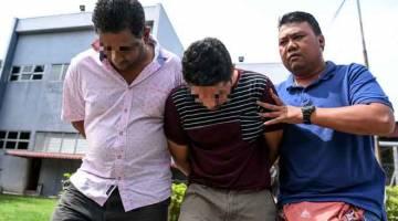 REMAN: Dua orang Pemilik Kedai Runcit dibawa ke mahkamah  bagi membantu siasatan berhubung dua kes kematian akibat keracunan alkohol di Mahkamah Majistret Ipoh dekat Ipoh, semalam. — Gambar Bernama