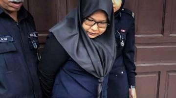 PECAH AMANAH: Wan Fatihah mengaku tidak bersalah di Mahkamah Sesyen, Ipoh, semalam atas 40 pertuduhan pecah amanah membabitkan RM68,463.35 pada Mei dan Julai tahun lepas. — Gambar Bernama