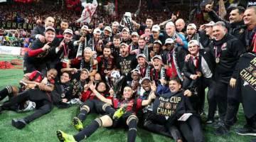 TAHNIAH: Atlanta United meraikan kejayaan memenangi MLS selepas menewaskan Portland Timber di Stadium Mercedes-Benz. — Gambar Reuters