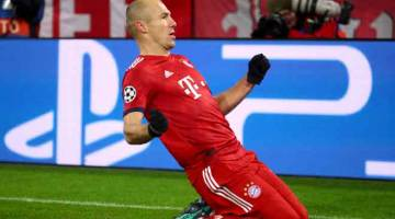 MUSIM TERAKHIR: Robben meraikan jaringannya ketika membantu Bayern menewaskan Benfica pada aksi Kumpulan E saingan Liga Juara-Juara di Allianz Arena, Munich pada 27 November lepas. — Gambar Reuters