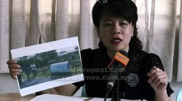 DIBINA: Yong menunjukkan gambar yang diambil di tapak pembinaan rumah baharu Tchee di Lorong 10A, Skim Penempatan Semula Stampin.