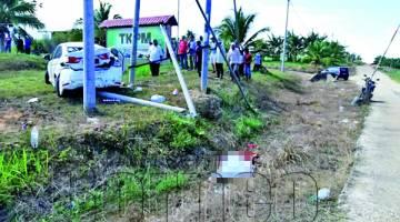 MANGSA maut di lokasi kejadian selepas tercampak keluar dari keretanya dipercayai akibat tidak memakai tali pinggang.