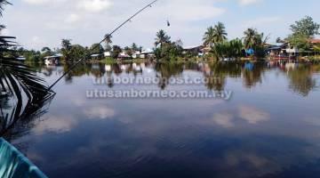 MENDAMAIKAN: Sungai Balingian dan perkampungan di Balingian menyajikan pemandangan yang indah.