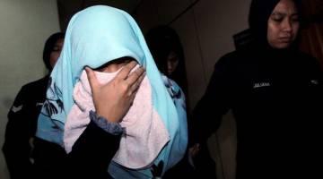 DIREMAN: Seorang wanita direman bagi membantu siasatan berhubung kematian seorang bayi lelaki berusia empat bulan dipercayai akibat tersedak susu ketika berada di bawah jagaannya mengikut Seksyen 304A Kanun Keseksaan. — Gambar Bernama