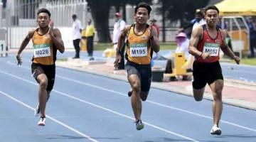 SEPENUH TENAGA: Muhammad Haiqal (tengah) mewakili negeri Johor dan Khairul (kiri) mewakili negeri Melaka beraksi dalam acara akhir 100 Meter pada Kejohanaan Kesatuan Olahraga Malaysia 2019 di Stadium Mini Majlis Sukan Negara, semalam. — Gambar Bernama