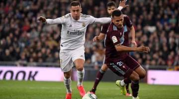 SELAMAT KEMBALI: Hazard beraksi pada perlawanan La Liga di antara Real Madrid dan Celta Vigo di Stadium Santiago Bernabeu di Madrid, pada 16 Februari lalu. — Gambar AFP