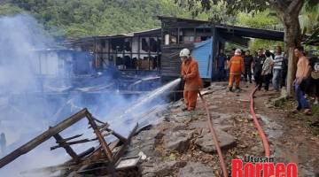 TERBAKAR: Kampung Seng Kee terbakar.