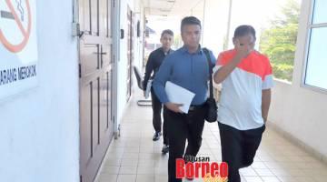RASUAH: Rhymei (kanan) keluar dari bilik mahkamah selepas selesai prosiding.