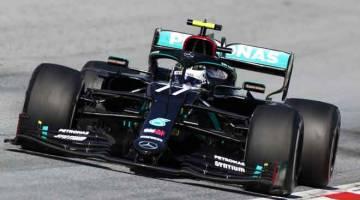 KEKAL TENANG: Bottas memandu jentera pada perlumbaan Grand Prix Formula Satu Austria kelmarin di Spielberg, Austria. — Gambar AFP