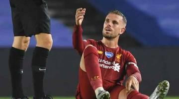 MASALAH: Henderson terduduk selepas mengalami kecederaan pada perlawanan EPL pada 8 Julai lalu. — Gambar AFP