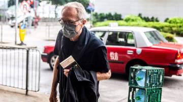 DIDAKWA: Progin tiba di Mahkamah Majistret Timur di Hong Kong, semalam bagi menghadapi tuduhan berkenaan insiden pada 2019. — Gambar AFP