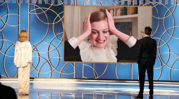MENANG BESAR: Gambar ihsan yang diserahkan oleh NBCUniversal ini menunjukkan Emma Corrin (di skrin) menerima anugerah aktres terbaik siri drama untuk 'The Crown' menerusi video daripada Kyra Sedgwick dan Kevin Bacon (kanan) semasa Anugerah Golden Globe ke-78 yang diadakan pada 28 Februari lepas. — Gambar AFP /NBCUniversal