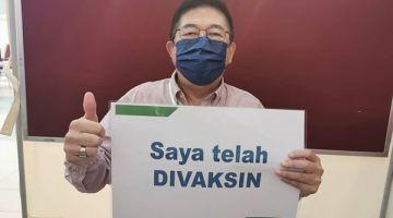 SUDAH DIVAKSIN: Jimmy ketika menerima dos pertama vaksin COVID-19