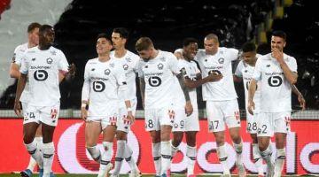 RAIKAN: Pemain Lille meraikan gol jaringan pada perlawanan Ligue 1 menentang Lens yang berlangsung di Stadium Bollaert di Lens. Lille menang 3-0. — Gambar AFP