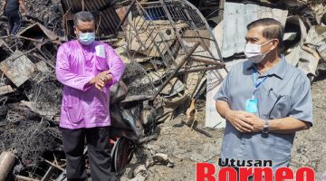 LAWAT : Hamild (kanan) melawat lokasi kebakaran.