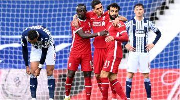 RAI: Mohamed Salah (dua kanan) meraikan gol kemenangan bersama rakan sepasukannya Roberto Firmino (tengah) dan Sadio Mane (dua kiri) pada perlawanan Liga Perdana Inggeris di antara West Bromwich Albion dan Liverpool di stadium Hawthorns di West Bromwich, kelmarin.  — Gambar AFP