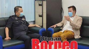 BINCANG:Limus (kanan) sedang berkata sesuatu kepada Yusoff Zaki (kiri) sempena kunjungan itu.