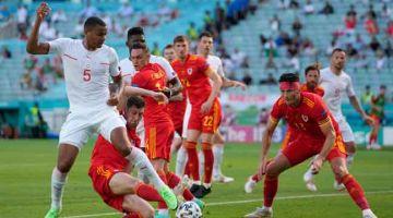 SENGIT: Sebahagian daripada aksi Euro 2020 Kumpulan A di antara Wales dan Switzerland di Stadium Olympic, Baku. — Gambar AFP