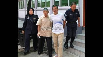 PENJARA DAN SEBATAN: Amin (dua kanan) dibawa keluar dari mahkamah oleh anggota polis setelah dijatuhkan hukuman atas 22 pertuduhan menipu.