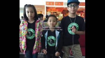 BAKAT CILIK: Dari kiri, Nur Aimah, Nurfan dan Hazwan bergambar di lapangan terbang Miri sebelum bertolak ke KL untuk program Hari Raya Astro.