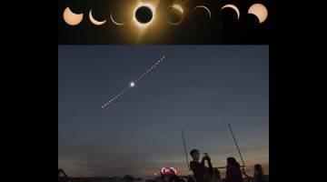 MEMUKAU: Kombinasi imej komposit gerhana matahari penuh dilihat dari Lowell Observatory Solar Eclipse Experience di Madras, Oregon kelmarin. — Gambar AFP