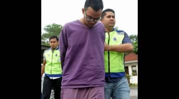 KEMUKA PENGADILAN: Abdul 'Azhim Mohamad dihadapkan di Mahkamah Majistret Telok Datok atas tuduhan membunuh Zaimah pada 11 Julai lepas di Kompleks Mahkamah Telok Datuk, Banting, semalam. — Gambar Bernama
