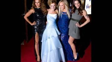 KEMBALI BERSAMA: Gambar fail bertarikh 11 Disember 2012 ini menunjukkan ahli kumpulan Spice Girls (dari kiri) Melanie Brown, Geri Halliwell, Emma Bunton dan Melanie Chisholm tiba untuk tayangan perdana muzikal  Spice Girls 'Viva Forever' di London. — Gambar AFP