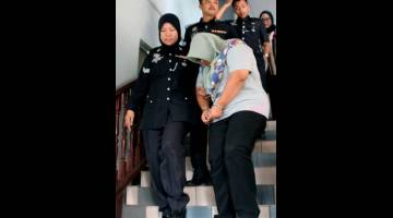 PECAH AMANAH: Nada mengaku tidak bersalah di Mahkamah Sesye, Melaka, semalam. — Gambar Bernama