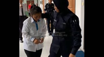 TERBONGKAR: Lai dibawa keluar dari mahkamah selepas pendakwaan atas pertuduhan pecah amanah.