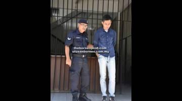 PECAH AMANAH: Wong dibawa keluar dari Mahkamah Sesyen setelah dijatuhkan hukuman semalam.