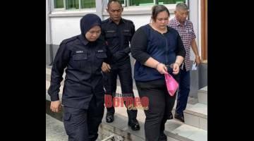 TIDAK MENGAKU: Cho dibawa keluar dari mahkamah setelah didakwa atas tiga pertuduhan menipu dan mengambil dadah.